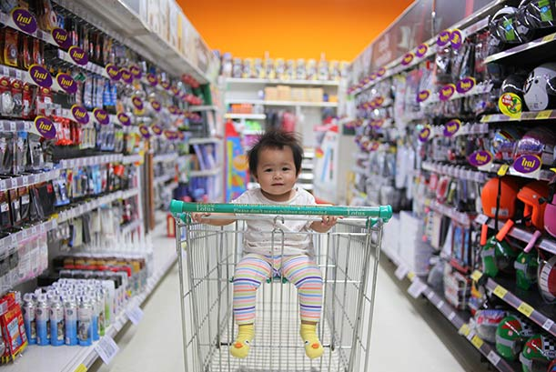 baby in shopping cart in store