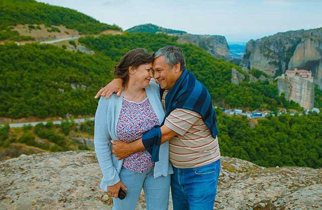 couple on mountain getting photo taken
