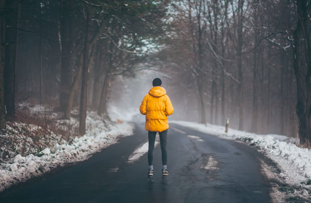 man in yellow jacket prepared for a winter jog