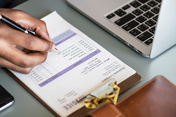 Person reviewing invoice
