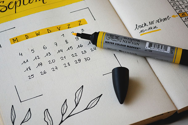 marker sitting on handwritten calendar